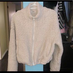 Cream coloured Sherpa jacket.
